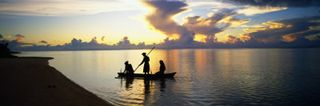 Panoramic-images-three-people-in-canoe-at-sunset-silhouette-amuri-lagoon-aitutaki-cook-islands